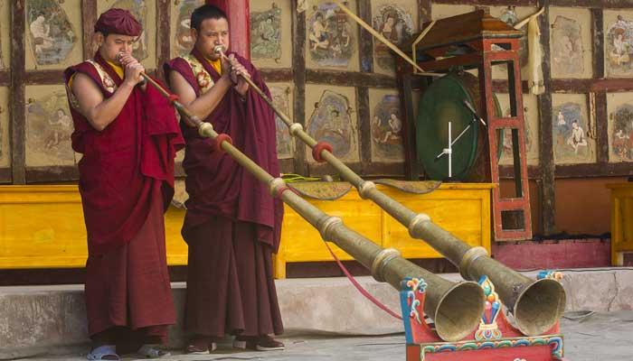 Buddhist monks playing dungchen