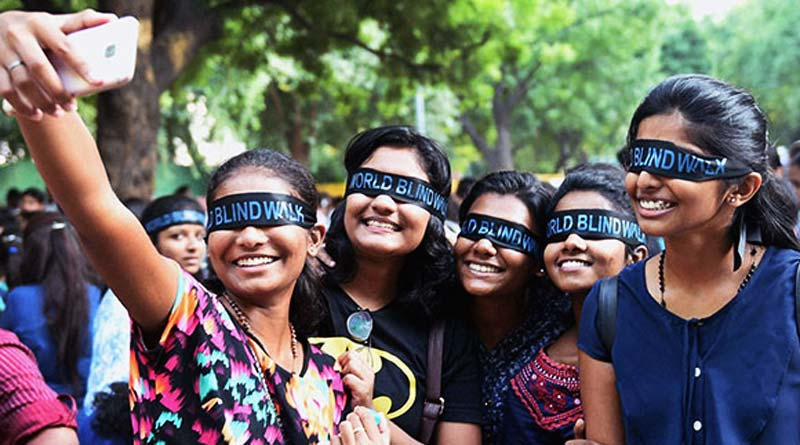 Blindfolded youngsters at the Blind Walk taking selfies