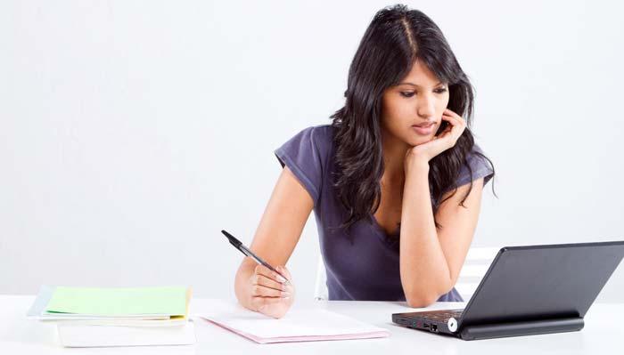 female university student writing