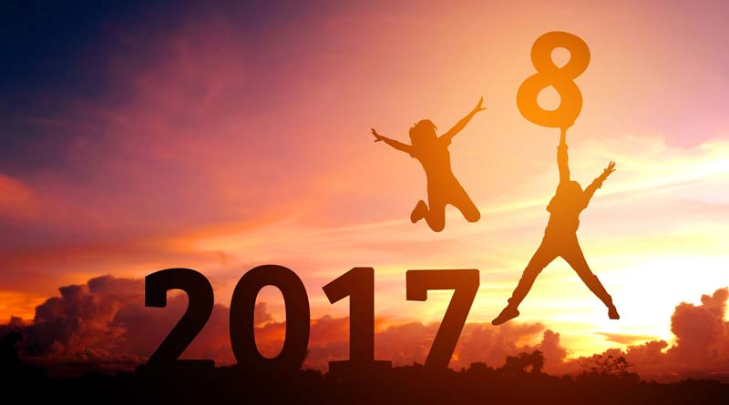Silhouettes of two people happy for new year 2018
