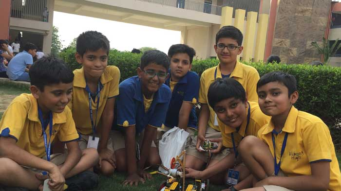 Students of Billabong High International School, Noida, with their scientific model made from junk