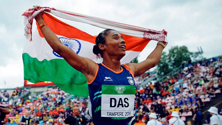 Hima Das holds aloft the Indian tricolour at Tampere 2018