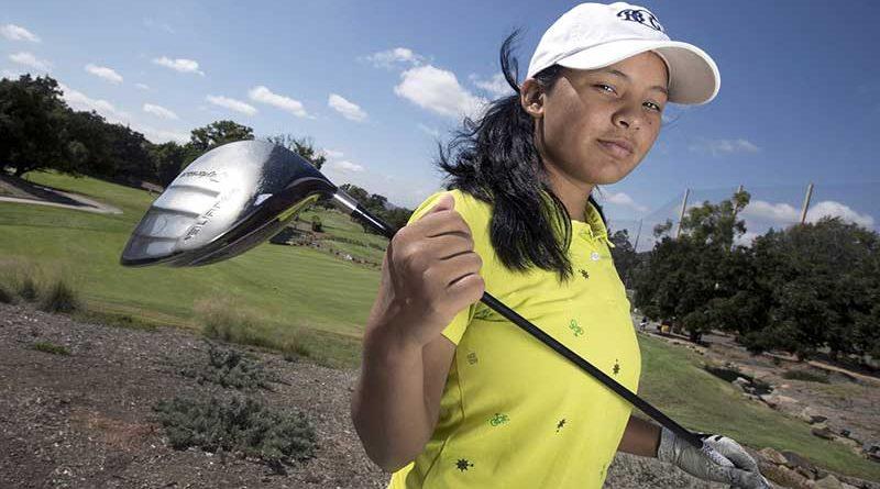 Pratima Sherpa carrying a golf club