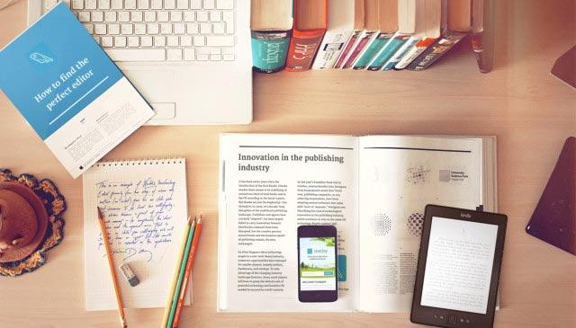Books, laptop, digital devices on desk
