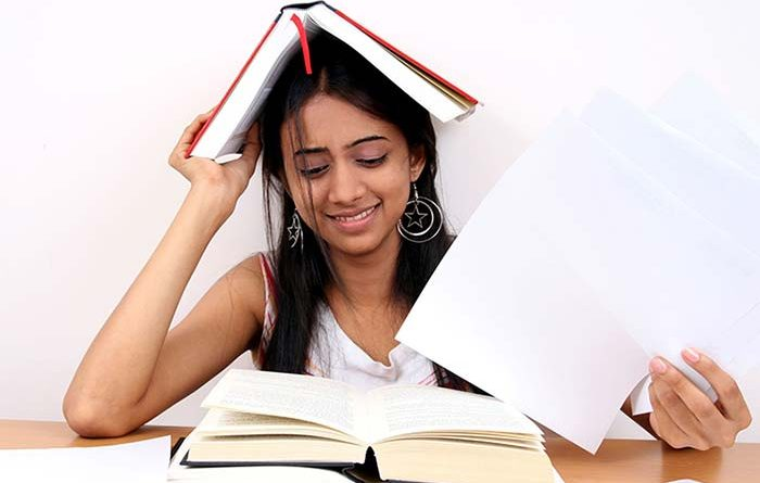 Teen girl looking anxious while preparing for exams