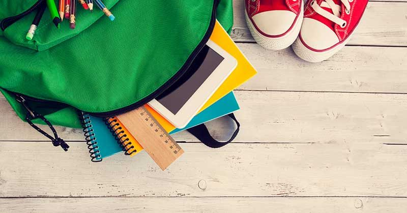 Backpack with stationery and shoes