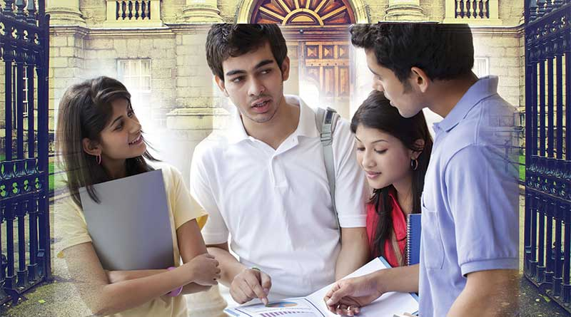 Group of students discussing studies in college