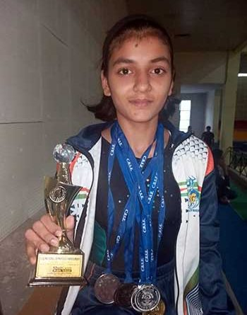 Komal Dhake of Holy Angels' School, Dombivli, with her medals and trophy