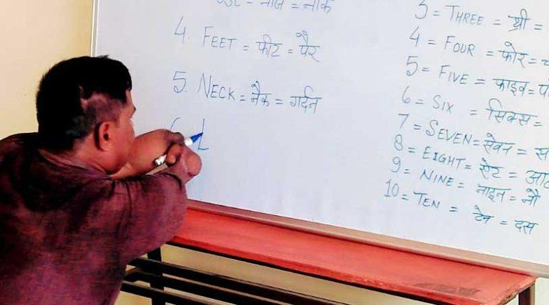 Shreenarayan writing on a blackboard