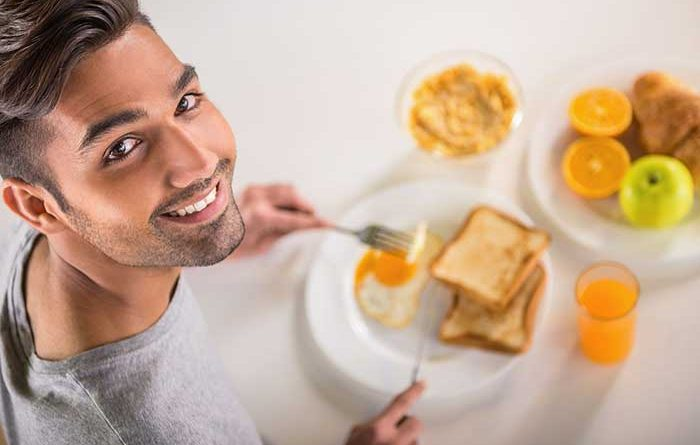 Young man eating a healthy breakfast