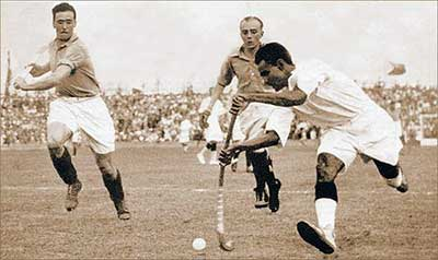 Dhyan Chand with the ball vs. France at the 1936 Olympic semi-finals in Berlin