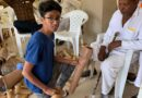 Veer Agrawal presenting a Jaipur Foot to a disabled man