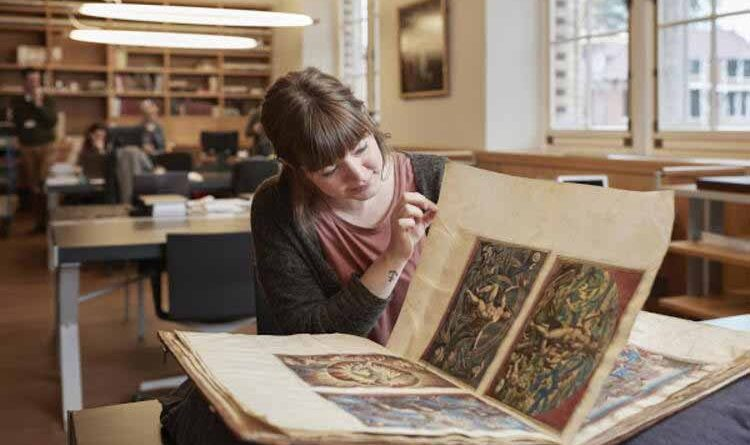 Female historian in a library