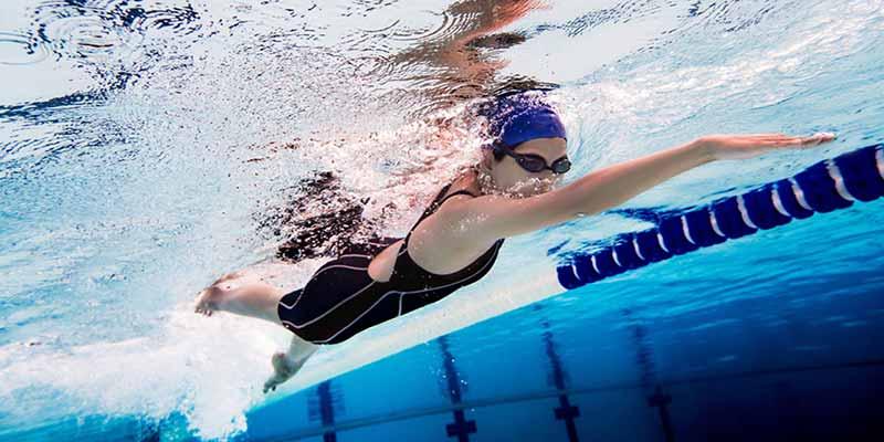 Female swimming in a swimming pool