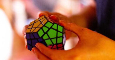 Hands solving Rubik's Cube