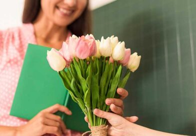 Student gifting flowers to teacher on Teachers' Day